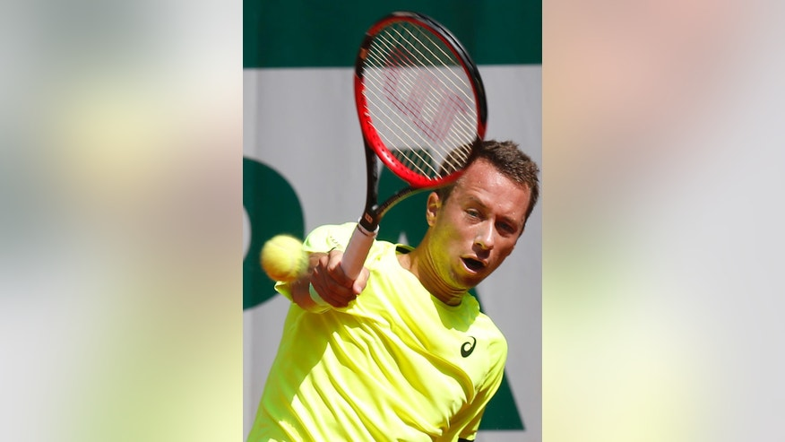 Germany's Philipp Kohlschreiber returns the ball to Japan's Go Soeda during their first round match of the French Open tennis tournament at the Roland Garros stadium, Sunday, May 24, 2015 in Paris. (AP Photo/Michel Euler)