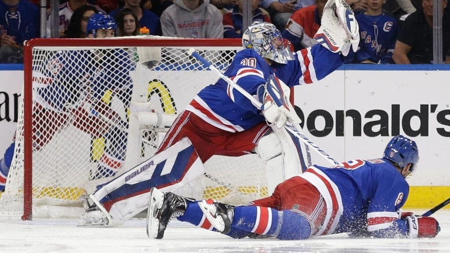 New York Rangers goalie Henrik Lundqvist (30) grabs a shot by Tampa Bay Lightning center Steven Stamkos (91) during the second period of Game 5 of the Eastern Conference final during the NHL hockey Stanley Cup playoffs, Sunday, May 24, 2015, in New York. (AP Photo/Frank Franklin)