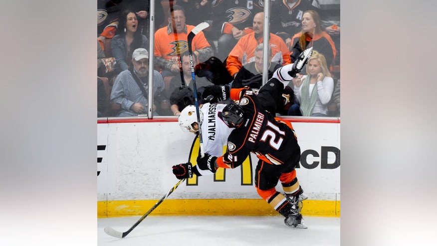 Anaheim Ducks right wing Kyle Palmieri, right, checks Chicago Blackhawks defenseman Niklas Hjalmarsson during the first period in Game 5 of the Western Conference final of the NHL hockey Stanley Cup playoffs in Anaheim, Calif., on Monday, May 25, 2015. (AP Photo/Mark J. Terrill)