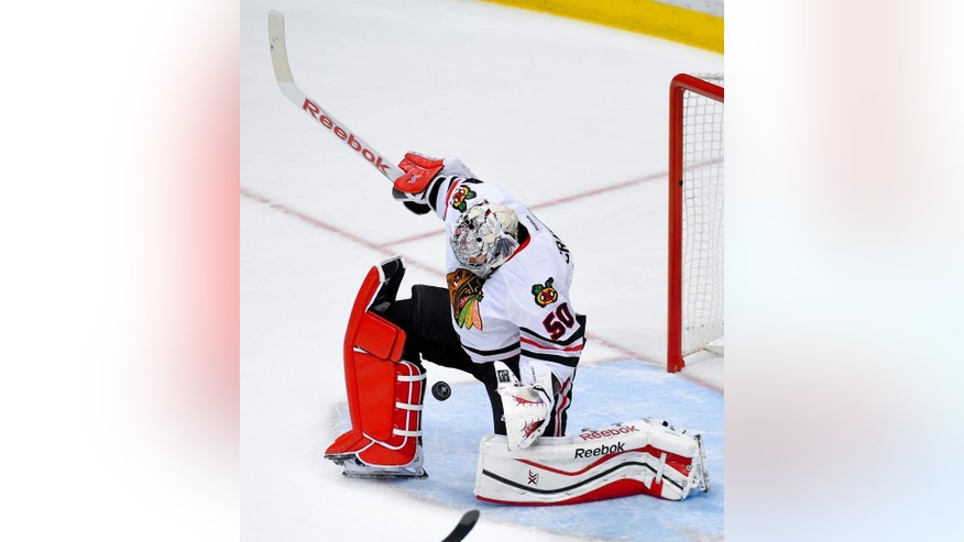 Chicago Blackhawks goalie Corey Crawford blocks a shot against the Anaheim Ducks during the first period in Game 5 of the Western Conference final of the NHL hockey Stanley Cup playoffs in Anaheim, Calif., on Monday, May 25, 2015. (AP Photo/Mark J. Terrill)