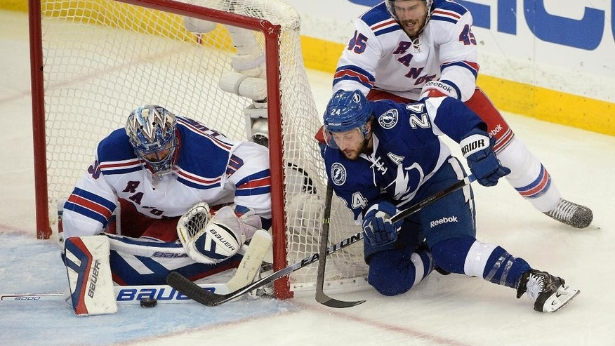 New York Rangers goalie Henrik Lundqvist (30), of Sweden, stops a shot from Tampa Bay Lightning right wing Ryan Callahan (24) as Rangers left wing James Sheppard (45) defends, during the second period of Game 6 of the Eastern Conference finals in the NHL hockey Stanley Cup playoffs, Tuesday, May 26, 2015, in Tampa, Fla. (AP Photo/Phelan M. Ebenhack)
