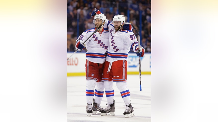 New York Rangers defenseman Keith Yandle, right, celebrates his goal with center Derick Brassard (16) during the first period of Game 6 of the Eastern Conference finals in the NHL hockey Stanley Cup playoffs Tuesday, May 26, 2015, in Tampa, Fla. (AP Photo/Chris O'Meara)