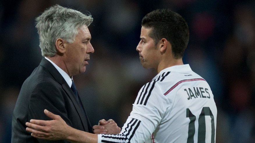 Carlo Ancelotti shakes hands with player James Rodriguez on April 18, 2015 in Madrid, Spain.