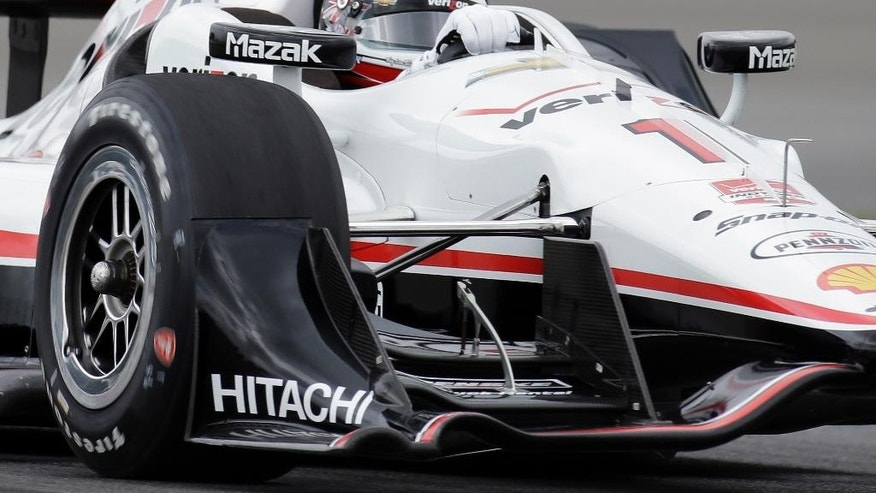 FILE -In this May 9, 2015, file photo, Will Power, of Australia, steers his car during a warm up session before the Grand Prix of Indianapolis auto race at the Indianapolis Motor Speedway in Indianapolis. Power heads to Detroit this weekend poised to make his 100th start for Team Penske. The milestone race will occur Sunday at Belle Isle, which hosts an IndyCar doubleheader this weekend.  (AP Photo/Darron Cummings, File)