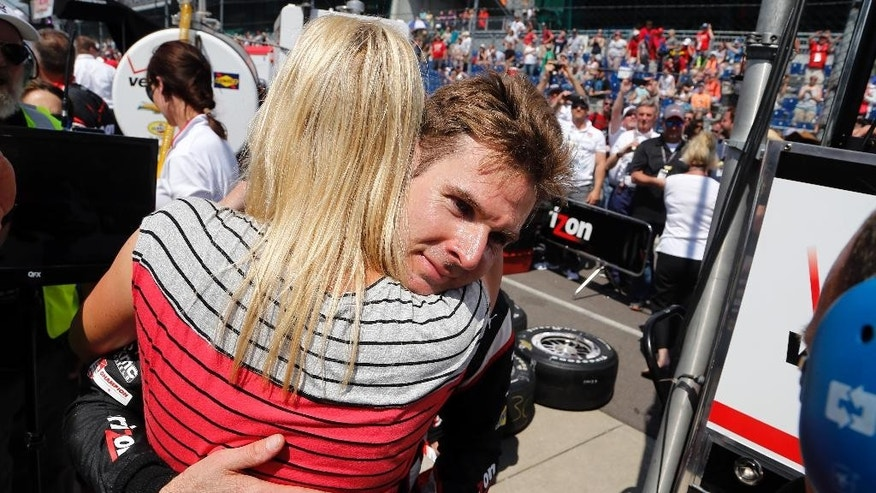 Will Power, of Australia, hugs his wife, Elizabeth, after finishing the 99th running of the Indianapolis 500 auto race at Indianapolis Motor Speedway in Indianapolis, Sunday, May 24, 2015.  (AP Photo/Sam Riche)