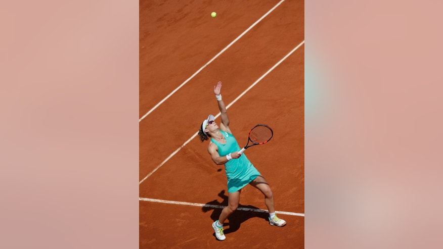 Australia's Samantha Stosur serves the ball to France's Amandine Hesse during their second round match of the French Open tennis tournament at the Roland Garros stadium, Wednesday, May, 27, 2015 in Paris.(AP Photo/Christophe Ena)