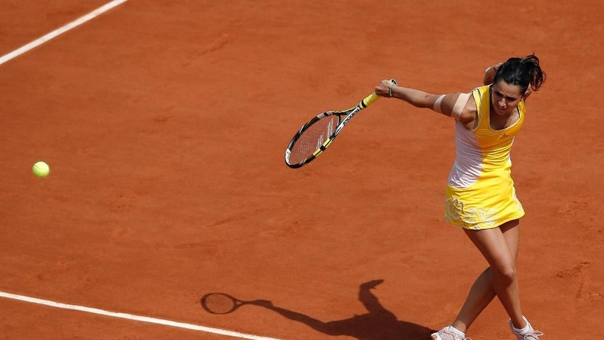 France's Amandine Hesse returns the ball to Australia's Samantha Stosur during their second round match of the French Open tennis tournament at the Roland Garros stadium, Wednesday, May, 27, 2015 in Paris.(AP Photo/Christophe Ena)