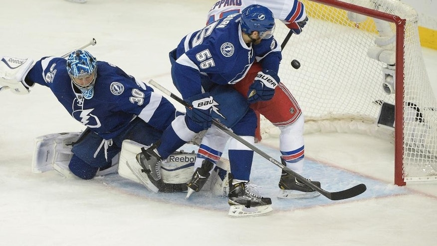 New York Rangers left wing James Sheppard (45) scores a goal againstTampa Bay Lightning goalie Ben Bishop (30) and defenseman Braydon Coburn (55) during the third  period of Game 6 of the Eastern Conference finals in the NHL hockey Stanley Cup playoffs,Tuesday, May 26, 2015, in Tampa, Fla. (AP Photo/Phelan M. Ebenhack)