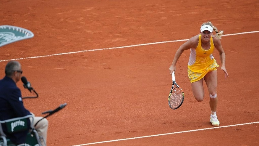 Denmark's Caroline Wozniacki runs to return the ball to Germany's Julia Goerges during their second round match of the French Open tennis tournament at the Roland Garros stadium, Thursday, May 28, 2015 in Paris. Georges won 6-4, 7-6.  (AP Photo/Christophe Ena)