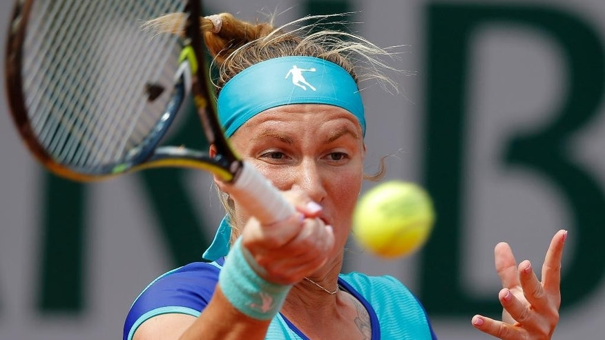 Russia's Svetlana Kuznetsova returns the ball to Italy's Francesca Schiavone during their second round match of the French Open tennis tournament at the Roland Garros stadium, Thursday, May 28, 2015 in Paris. (AP Photo/Francois Mori)