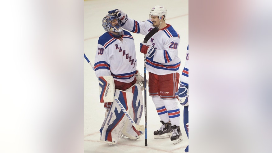 New York Rangers left wing Chris Kreider (20) celebrates with goalie Henrik Lundqvist (30), of Sweden, after the Rangers defeated the Tampa Bay Lightning 7-3 in Game 6 of the Eastern Conference finals in the NHL hockey Stanley Cup playoffs, Tuesday, May 26, 2015, in Tampa, Fla. (AP Photo/Phelan M. Ebenhack)