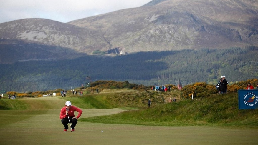 Northern Ireland's Rory McIlroy lines up a putt on hole 11 during round one of the Irish Open Golf Championship at Royal County Down, Newcastle, Northern Ireland, Thursday, May 28, 2015.  (AP Photo/Peter Morrison)