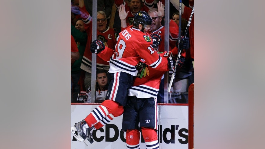Chicago Blackhawks left wing Brandon Saad (20) celebrates his goal against the Anaheim Ducks with Chicago Blackhawks center Jonathan Toews (19) during the second period in Game 6 of the Western Conference finals of the NHL hockey Stanley Cup Playoffs, Wednesday, May 27, 2015, in Chicago. (AP Photo/Nam Y. Huh)