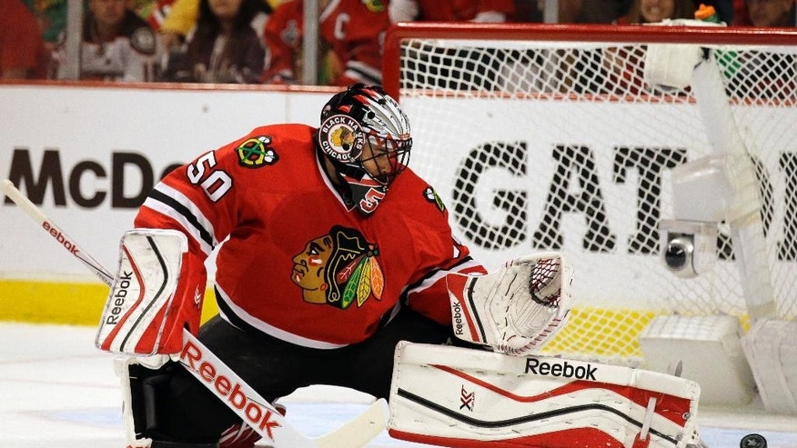 Chicago Blackhawks goalie Corey Crawford (50) makes a save against the Anaheim Ducks during the first period in Game 6 of the Western Conference finals of the NHL hockey Stanley Cup Playoffs, Wednesday, May 27, 2015, in Chicago. (AP Photo/Nam Y. Huh)