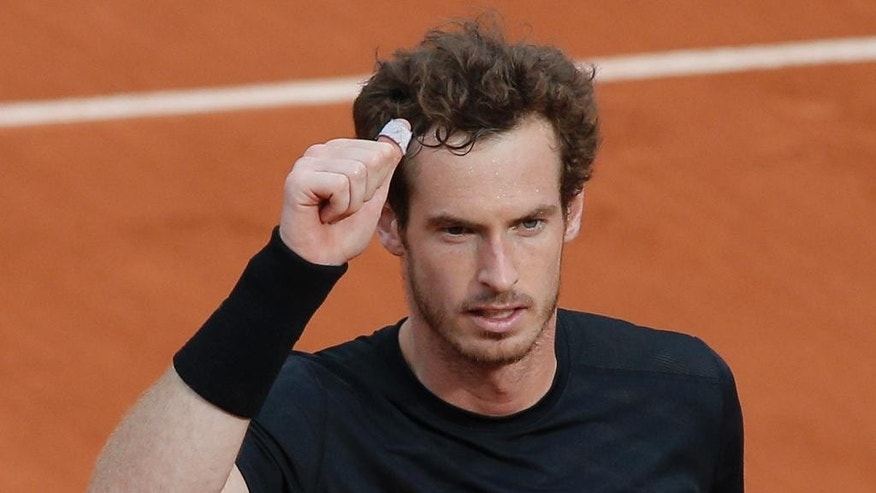 Britain's Andy Murray gives a thumbs up after winning his second round match of the French Open tennis tournament against Portugal's Joao Sousa in four sets 6-2, 4-6, 6-4, 6-1, at the Roland Garros stadium, in Paris, France, Thursday, May 28, 2015. (AP Photo/Christophe Ena)