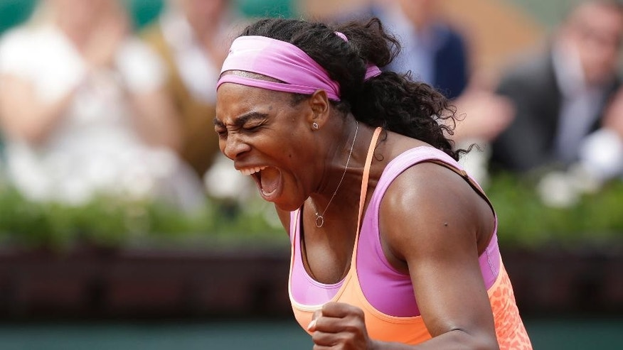 Serena Williams of the U.S. celebrates winning the second round match of the French Open tennis tournament against Germany's Anna-Lena Friedsam in three sets 5-7, 6-3, 6-3, at the Roland Garros stadium, in Paris, France, Thursday, May 28, 2015. (AP Photo/Thibault Camus)