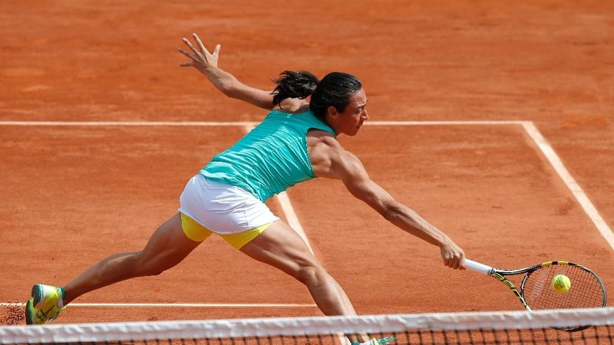 Italy's Francesca Schiavone returns the ball to Russia's Svetlana Kuznetsova during their second round match of the French Open tennis tournament at the Roland Garros stadium, Thursday, May 28, 2015 in Paris. (AP Photo/Francois Mori)