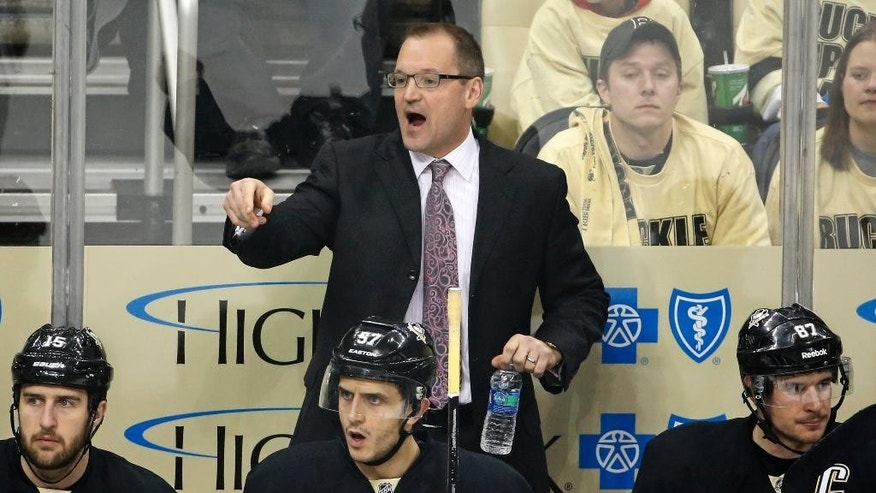 FILE - In this May 2, 2014, file photo, then-Pittsburgh Penguins head coach Dan Bylsma gives instructions in the first period of Game 1 in the second round  of the NHL hockey Stanley Cup playoffs against the New York Rangers in Pittsburgh. The Buffalo Sabres have reached an agreement in principle to hire the former Penguins coach, a person familiar with the talks told The Associated Press on Thursday, May 28, 2015. (AP Photo/Gene J. Puskar, File)