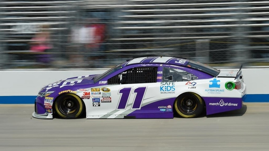 Denny Hamlin drives his car during qualifying for Sunday's NASCAR Sprint Cup series auto race, Friday, May 29, 2015, at Dover International Speedway in Dover, Del. Hamlin won the pole. (AP Photo/Nick Wass)