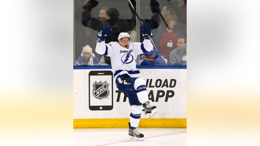 Tampa Bay Lightning left wing Ondrej Palat  celebrates his third period goal against the New York Rangers during Game 7 of the Eastern Conference final during the NHL hockey Stanley Cup playoffs, Friday, May 29, 2015, in New York. (AP Photo/Kathy Willens)
