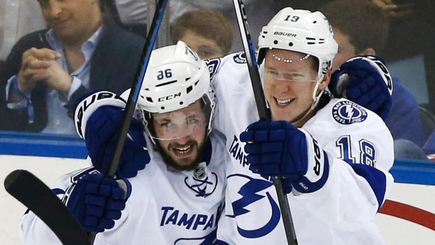 Tampa Bay Lightning right wing Nikita Kucherov (86) and left wing Ondrej Palat (18) celebrate Palat's third period goal against the New York Rangers during Game 7 of the Eastern Conference final during the NHL hockey Stanley Cup playoffs, Friday, May 29, 2015, in New York. (AP Photo/Kathy Willens)