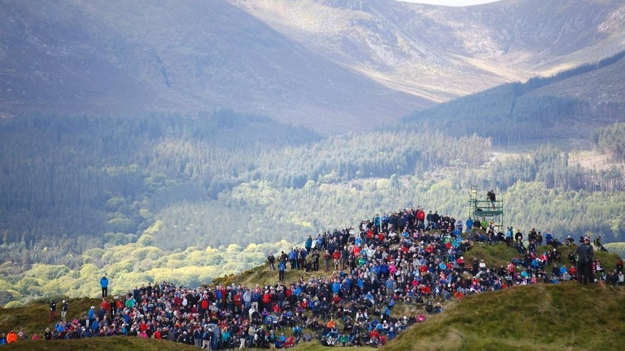 Golf fans wait for Ireland's Padraig Harrington  during round two of the Irish Open Golf Championship at Royal County Down, Newcastle, Northern Ireland, Friday, May 29, 2015.  (AP Photo/Peter Morrison)