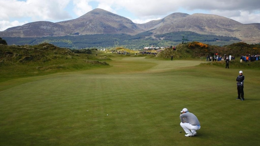 Ireland's Padraig Harrington lines up his putt on hole 3 during round two of the Irish Open Golf Championship at Royal County Down, Newcastle, Northern Ireland, Friday, May 29, 2015.  (AP Photo/Peter Morrison)