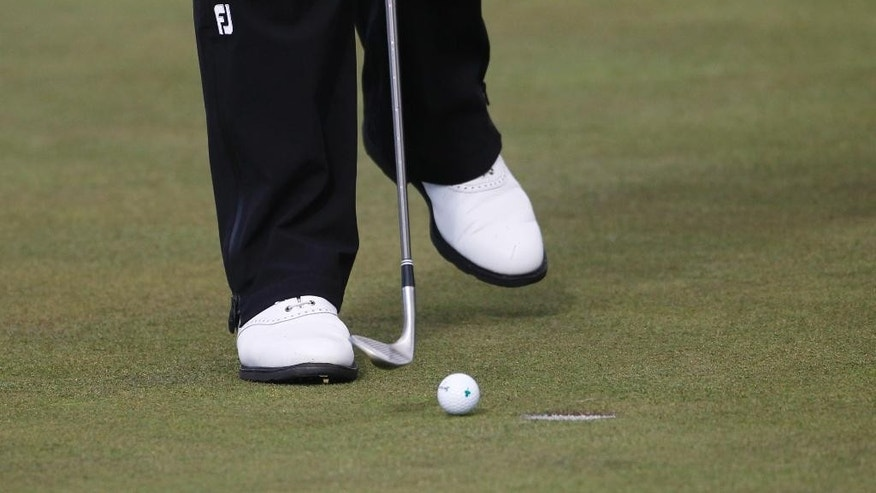 Ireland's Shane Lowry putts with his wedge after breaking his putter on his golf bag  during round two of the Irish Open Golf Championship at Royal County Down, Newcastle, Northern Ireland, Friday, May 29, 2015.  (AP Photo/Peter Morrison)