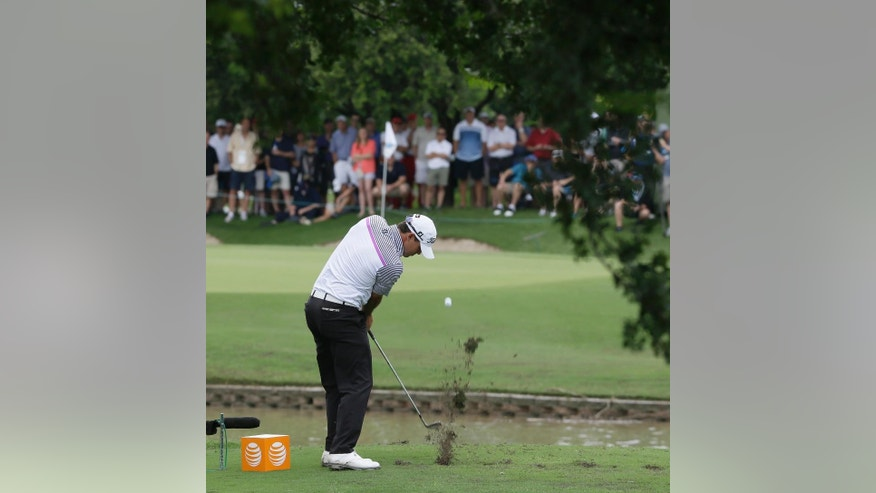 Brooks Koepka hits a tee shot on a shortened 14th hole during the second round of the Byron Nelson golf tournament, Friday, May 29, 2015, in Irving, Texas. The 14th fairway was washed over by a flash flood so the the hole was shortened to a 100-yard par 3. (AP Photo/LM Otero)