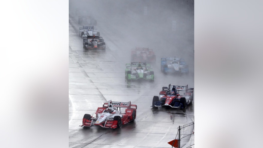 Juan Pablo Montoya leads the field during the first race of the IndyCar Detroit Grand Prix auto racing doubleheader Saturday, May 30, 2015, in Detroit. (AP Photo/Dave Frechette)
