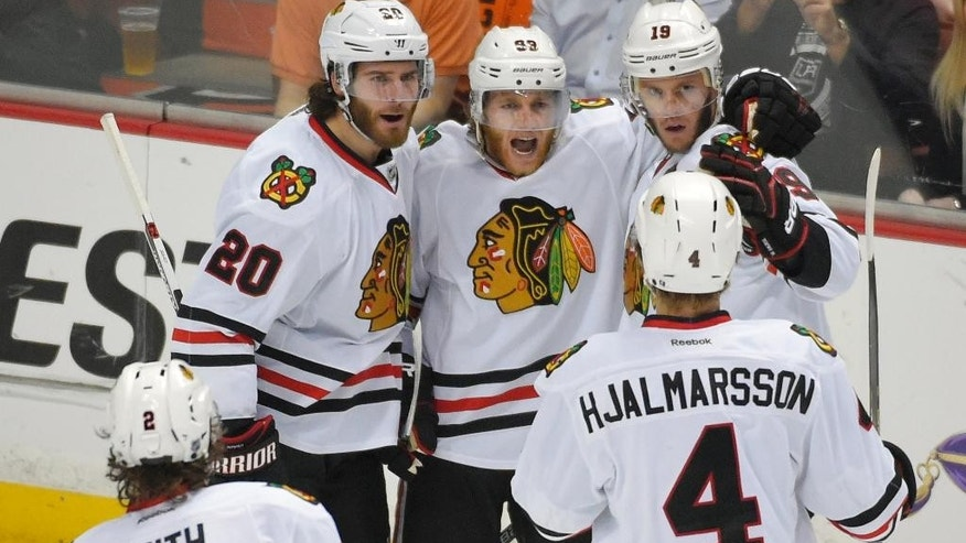 Members of the Chicago Blackhawks celebrate center Jonathan Toews's (19) goal against the Anaheim Ducks during the first period in Game 7 of the Western Conference final of the NHL hockey Stanley Cup playoffs in Anaheim, Calif., Saturday, May 30, 2015.  (AP Photo/Mark J. Terrill)