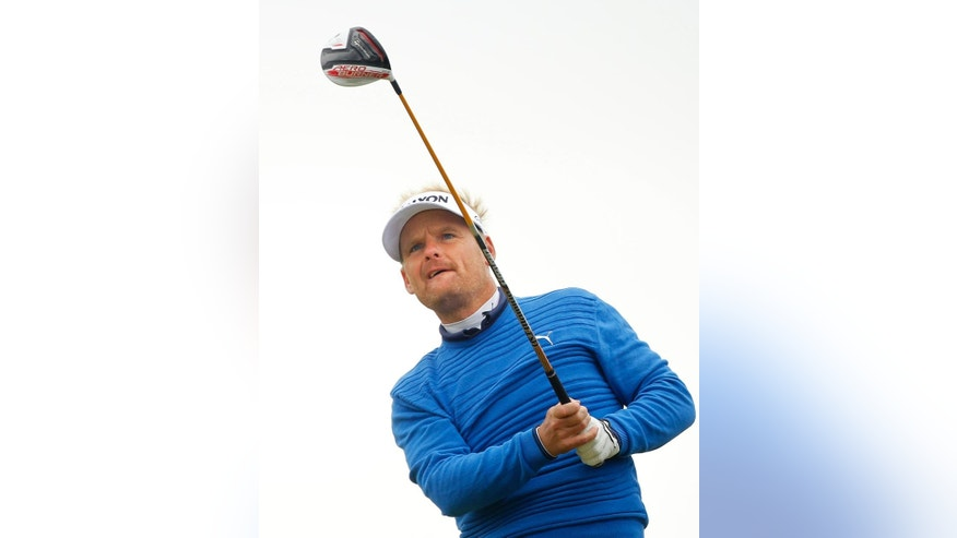 Denmark's Soren Kjeldsen tees off on the 8th hole during round three of the Irish Open Golf Championship at Royal County Down, Newcastle, Northern Ireland, Saturday, May 30, 2015.  (AP Photo/Peter Morrison)