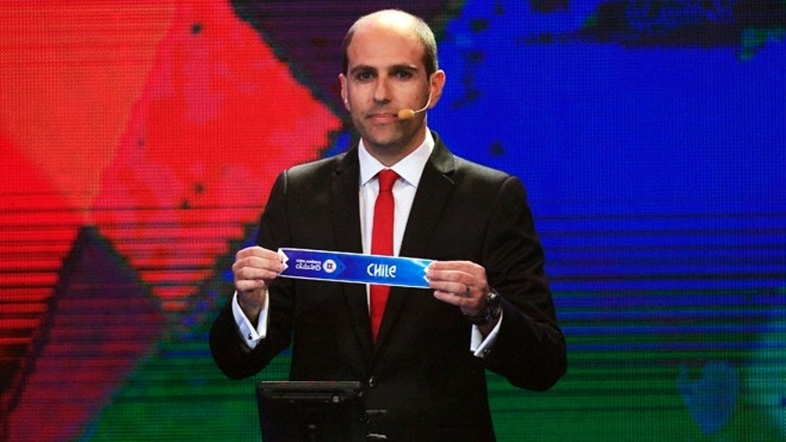 FILE - In this Nov. 24, 2014 file photo, Sergio Jadue, president of the Chilean Football Association, shows a ballot with Chiles name as the first pick for group 1, during the draw for the 2015 Copa America tournament in Vina del Mar, Chile. Within hours of the FIFA scandal breaking in late May 2015, Jadue was declaring his innocence, comments that raised eyebrows because he wasnt formally accused of anything. He was referring to a part of the sweeping U.S. Justice Department indictments that, without specifying them by name, said the 10 presidents of the South American Football Confederation were to receive bribes in exchange for transmission rights to games of the Copa America. (AP Photo/Luis Hidalgo, File)
