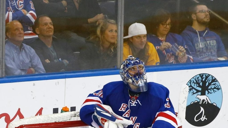 New York Rangers goalie Henrik Lundqvist (30) looks up at the scoreboard after a third period goal by the Tampa Bay Lightning during Game 7 of the Eastern Conference final during the NHL hockey Stanley Cup playoffs, Friday, May 29, 2015, in New York. (AP Photo/Kathy Willens)