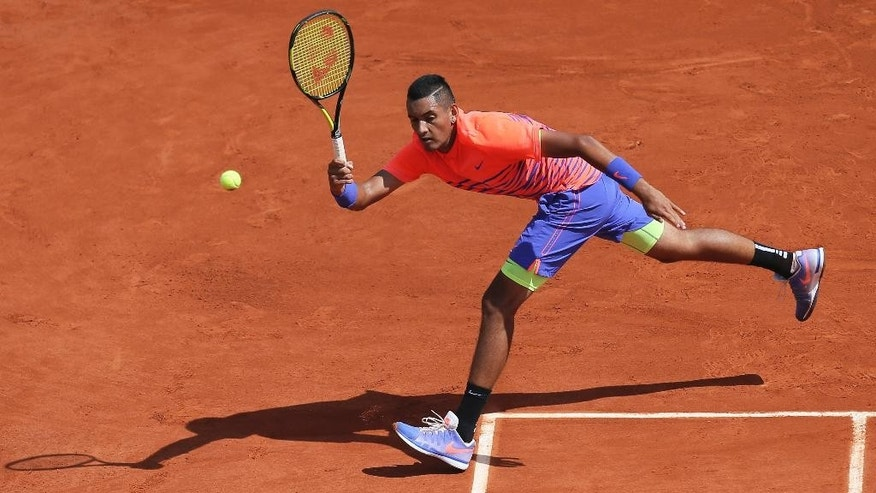 Australia's Nick Kyrgios returns in the third round match of the French Open tennis tournament against Britain's Andy Murray at the Roland Garros stadium, in Paris, France, Saturday, May 30, 2015. (AP Photo/David Vincent)