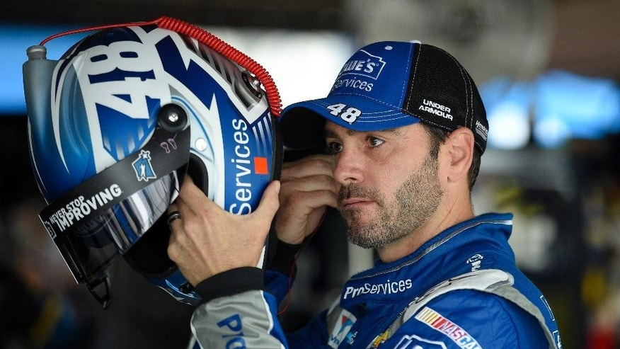 Jimmie Johnson prepares his equipment during practice, Friday, May 29, 2015, for Sunday's NASCAR Sprint Cup series auto race at Dover International Speedway in Dover, Del. (AP Photo/Nick Wass)