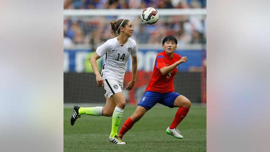 United States midfielder Morgan Brian, left, and South Korea defender Kim Sooyun chase after the ball during the first half of an international friendly soccer match, Saturday, May 30, 2015, in Harrison, N.J. (AP Photo/Julio Cortez)