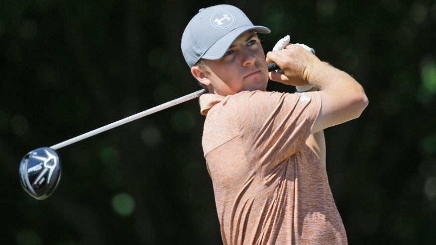 Jordan Spieth watches his tee shot on the first hole during the final round of the Byron Nelson golf tournament, Sunday, May 31, 2015, in Irving, Texas. (AP Photo/LM Otero)