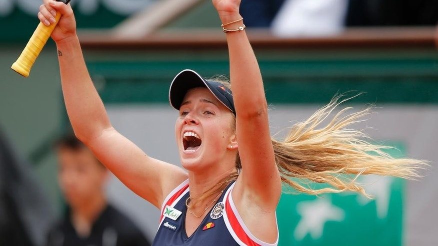 Ukraine's Elina Svitolina reacts as she defeats France's Alize Cornet during their fourth round match of the French Open tennis tournament at the Roland Garros stadium, Sunday, May 31, 2015 in Paris, France. (AP Photo/Francois Mori)