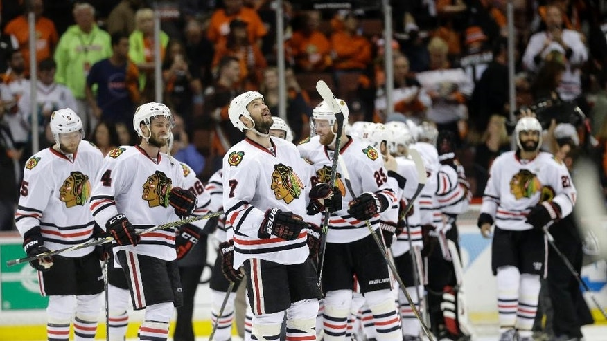 Members of the Chicago Blackhawks celebrate their win against the Anaheim Ducks in Game 7 of the Western Conference final of the NHL hockey Stanley Cup playoffs in Anaheim, Calif., Saturday, May 30, 2015. The Blackhawks won 5-3 to advance to Stanley Cup Finals. (AP Photo/Jae C. Hong)