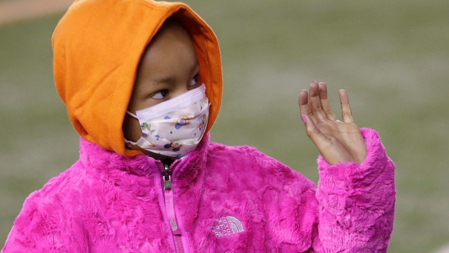Nov. 6, 2014:  Leah Still waves during a ceremony in the first half of an NFL football game between the Cincinnati Bengals and the Cleveland Browns in Cincinnati.