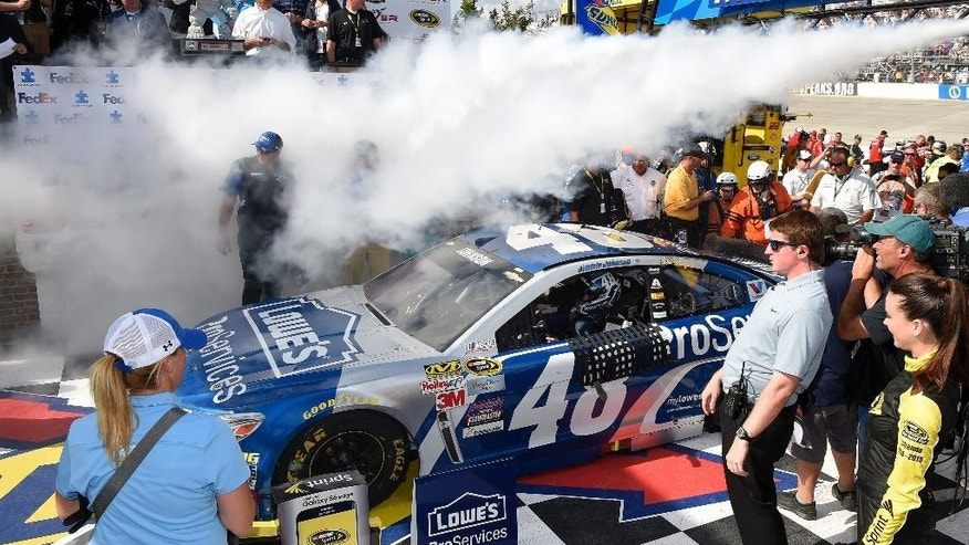 Jimmie Johnson pulls into Victory Lane after he won the NASCAR Sprint Cup series auto race, Sunday, May 31, 2015, at Dover International Speedway in Dover, Del. (AP Photo/Nick Wass)