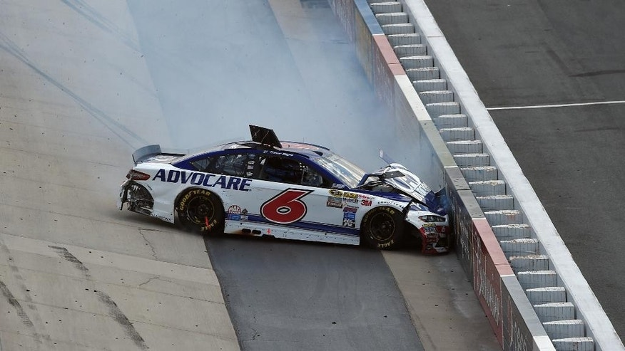 Trevor Bayne wrecks into a wall during a NASCAR Sprint Cup series auto race, Sunday, May 31, 2015, at Dover International Speedway in Dover, Del. (AP Photo/Nick Wass)