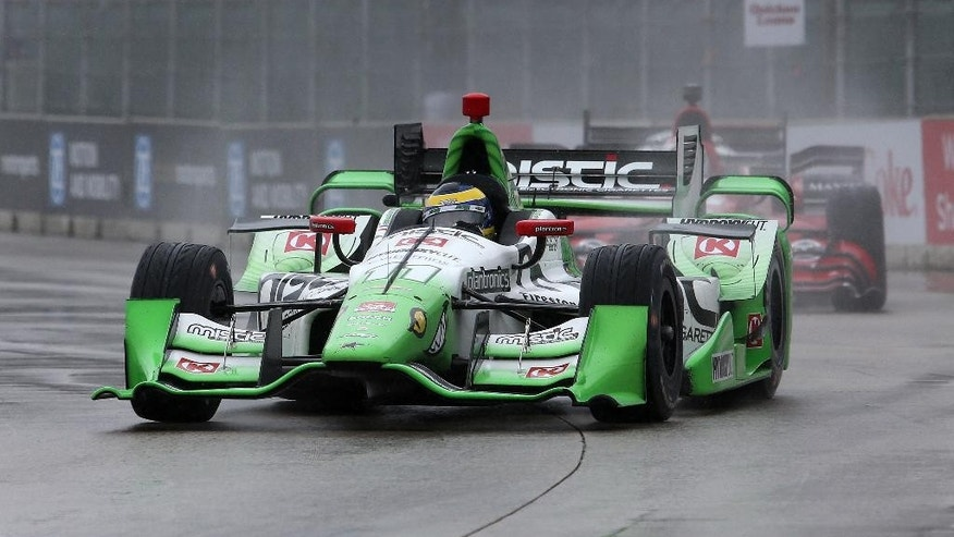 Sebastien Bourdais, of France, drives in the rain during the second race of the IndyCar Detroit Grand Prix auto racing doubleheader Sunday, May 31, 2015, in Detroit. (AP Photo/Dave Frechette)