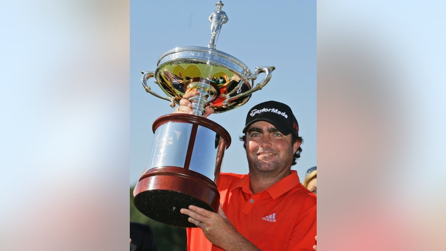 Steven Bowditch poses with the trophy after winning the Byron Nelson golf tournament, Sunday, May 31, 2015, in Irving, Texas. Bowditch won with a 16-under score. (AP Photo/LM Otero)