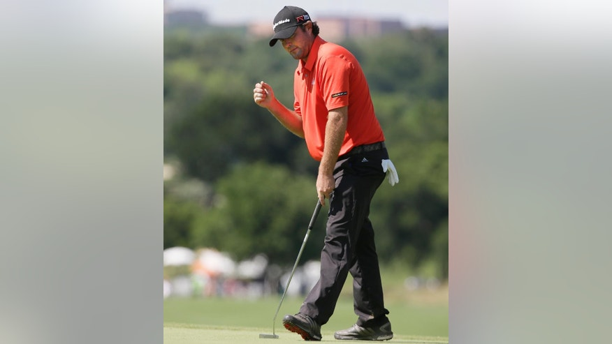 Steven Bowditch reacts after sinking a putt on the 16th green during the final round of the Byron Nelson golf tournament, Sunday, May 31, 2015, in Irving, Texas. Bowditch won the tournament. (AP Photo/LM Otero)