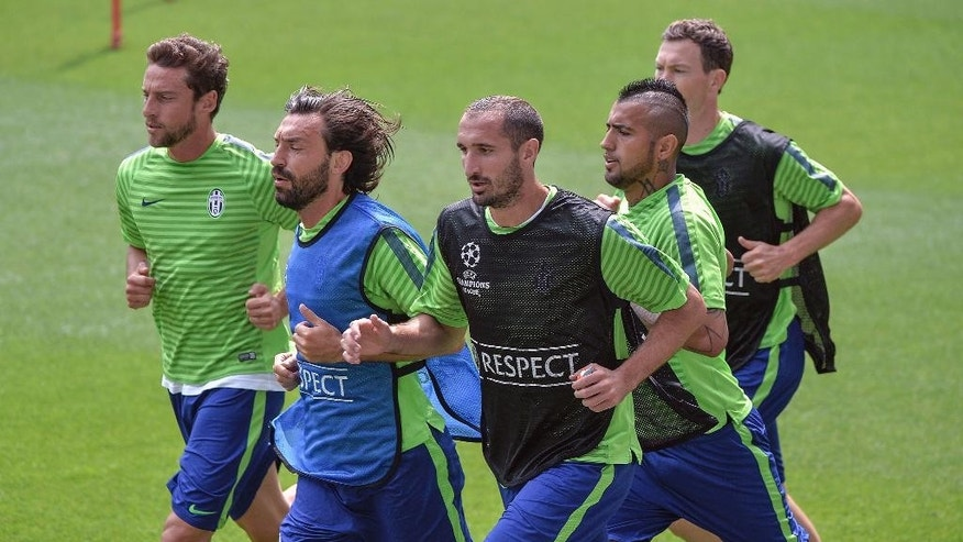 Juventus', from left, Claudio Marchisio, Andea Pirlo, Giorgio Chiellini, Arturo Vidal and Stephan Lichtsteiner warm up during a training session ahead of Saturday's Champions League final soccer match against Barcelona, at the Juventus stadium in Turin, Italy, Monday, June 1, 2015 (AP Photo/Massimo Pinca)