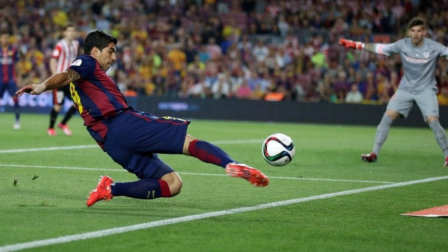 Barcelona's Luis Suarez attempts a shot at goal during the final of the Copa del Rey soccer match between FC Barcelona and Athletic Bilbao at the Camp Nou stadium in Barcelona, Spain, Saturday, May 30, 2015. (AP Photo/Manu Fernandez)