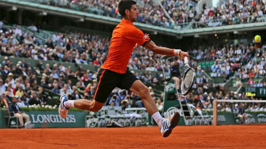 Serbia's Novak Djokovic returns the ball to France's Richard Gasquet during their fourth round match of the French Open tennis tournament at the Roland Garros stadium, Monday, June 1, 2015 in Paris.  (AP Photo/David Vincent)