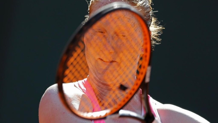 Belgium's Alison van Uytvanck returns in the fourth round match of the French Open tennis tournament against Romania's Andrea Mitu to win in two sets 6-1, 6-1, at the Roland Garros stadium, in Paris, France, Monday, June 1, 2015. (AP Photo/Thibault Camus)